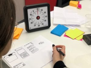 person drawing out a framework with a timer