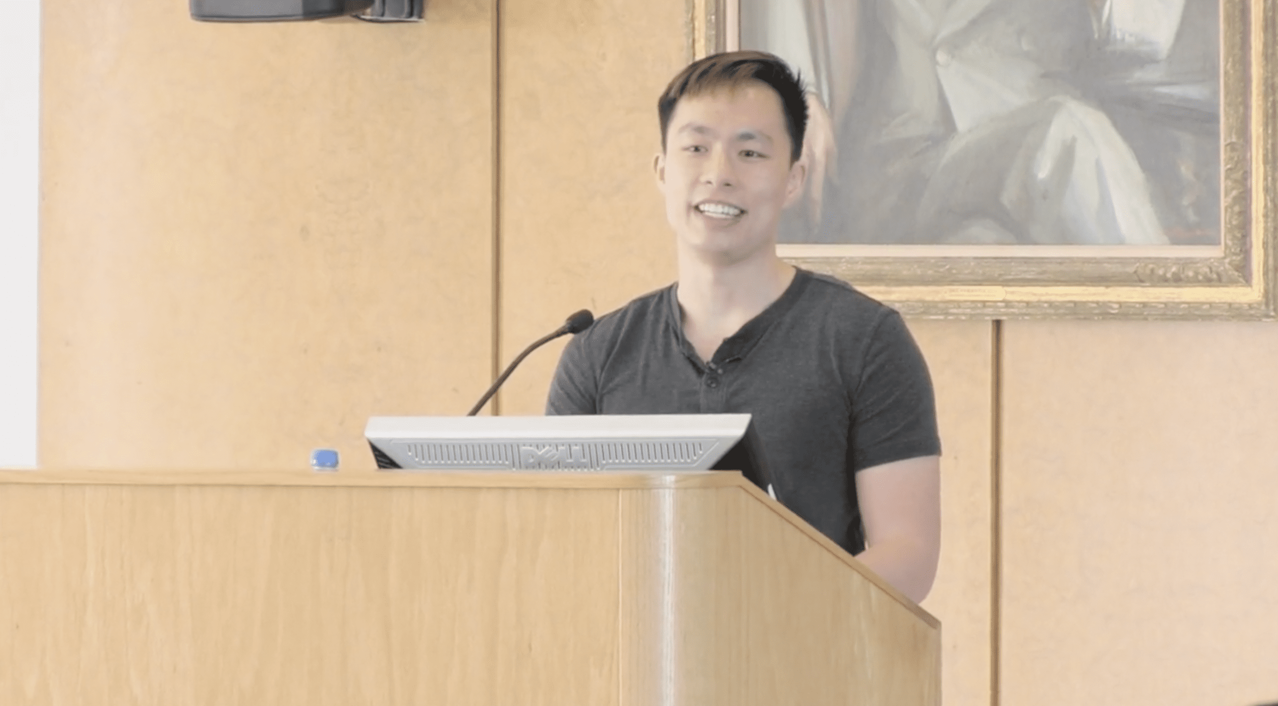 Davis Nguyen in front of an audience for the Questions and Answers