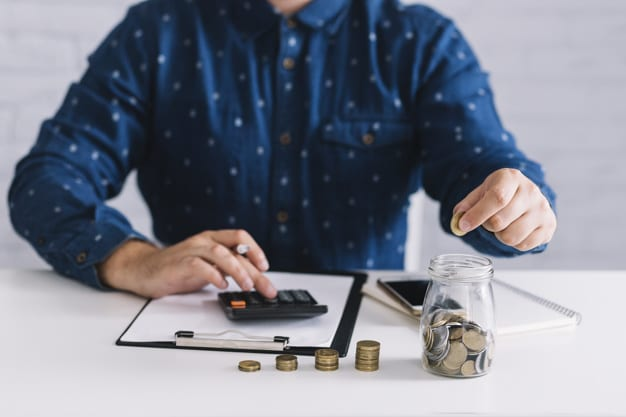 Profitability Framework. Image is of a man counting up money with a calculator.