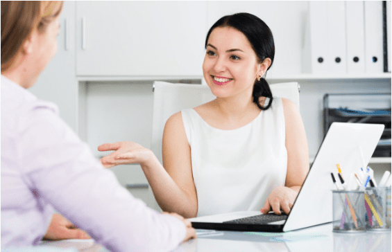 Do consulting firms hire during an economic downturn? Image shows 2 business women in a meeting.