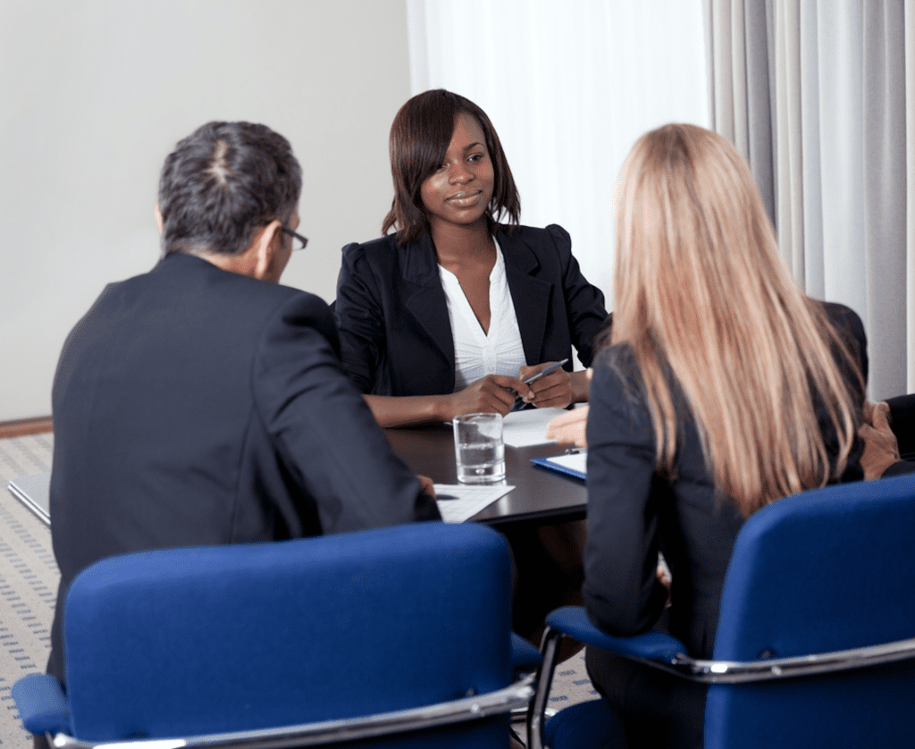 Three people on suits conducting a interviewer vs interviewee led case